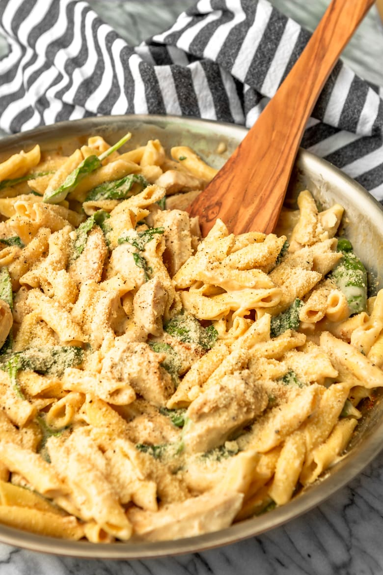 chicken spinach alfredo in a skillet