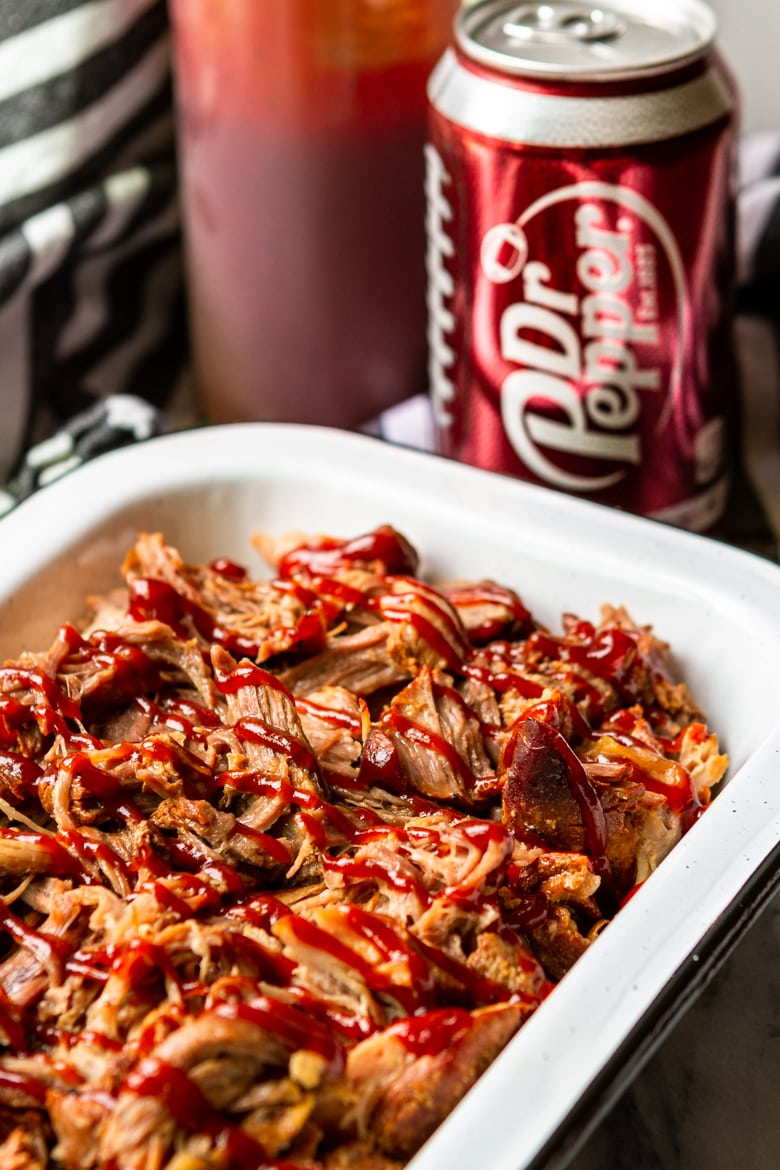 dr pepper pulled pork in instant pot drizzled with bbq sauce
