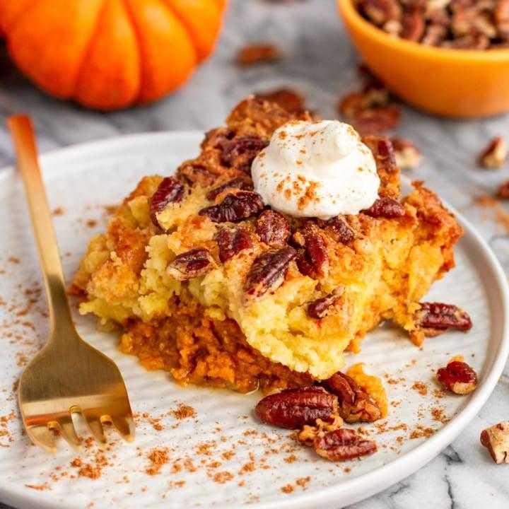 pumpkin dump cake recipe served with homemade whipped cream