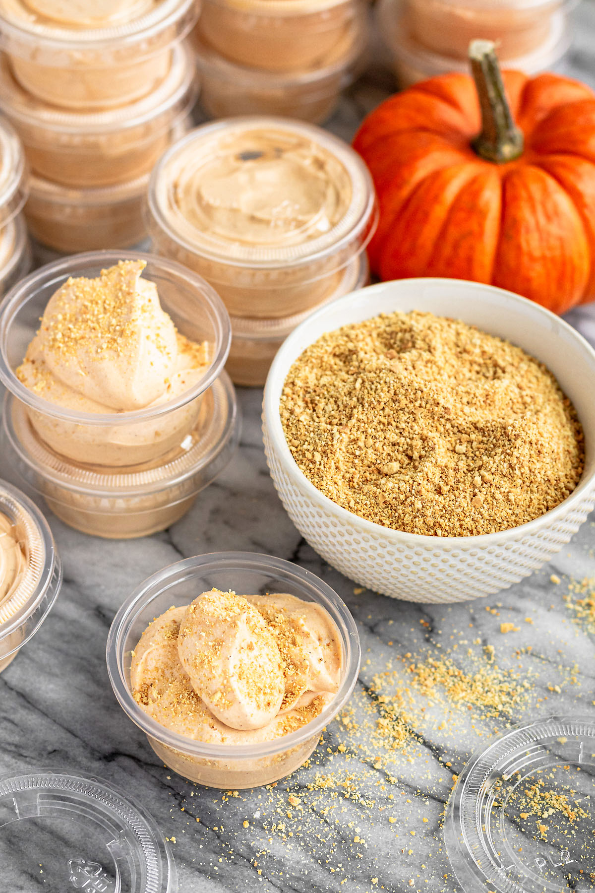 pumpkin pie pudding shots topped with graham cracker crumbs