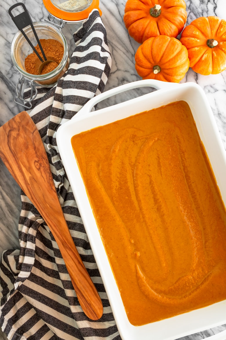 pumpkin spice dump cake filling in a white baking dish