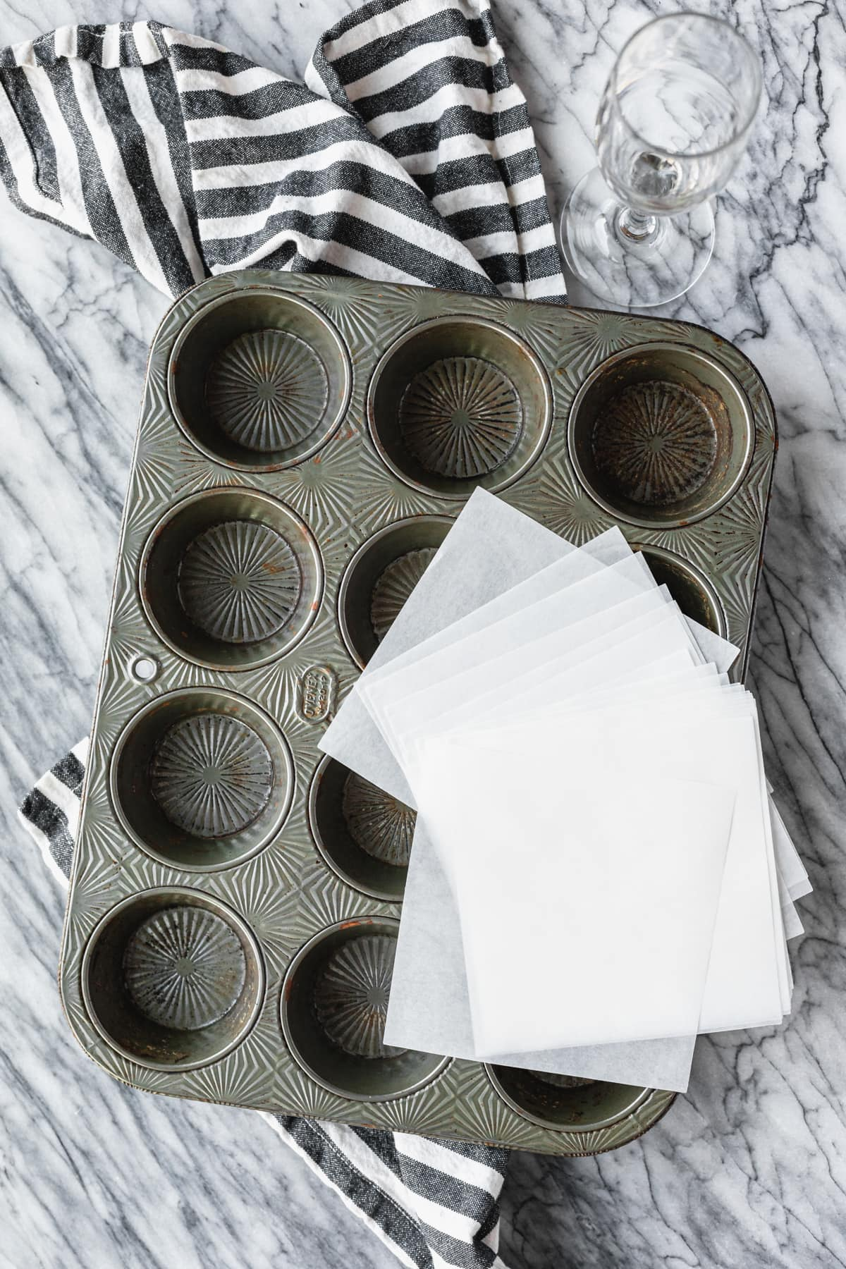 supplies for diy tulip cupcake liners: parchment paper and glass