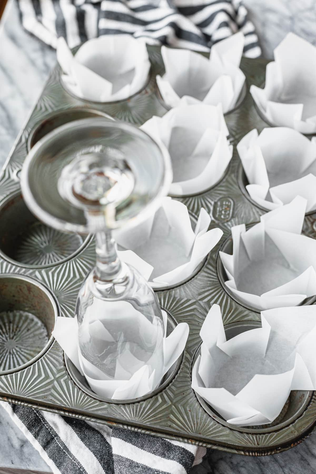 making diy parchment paper muffin liners with a champagne glass