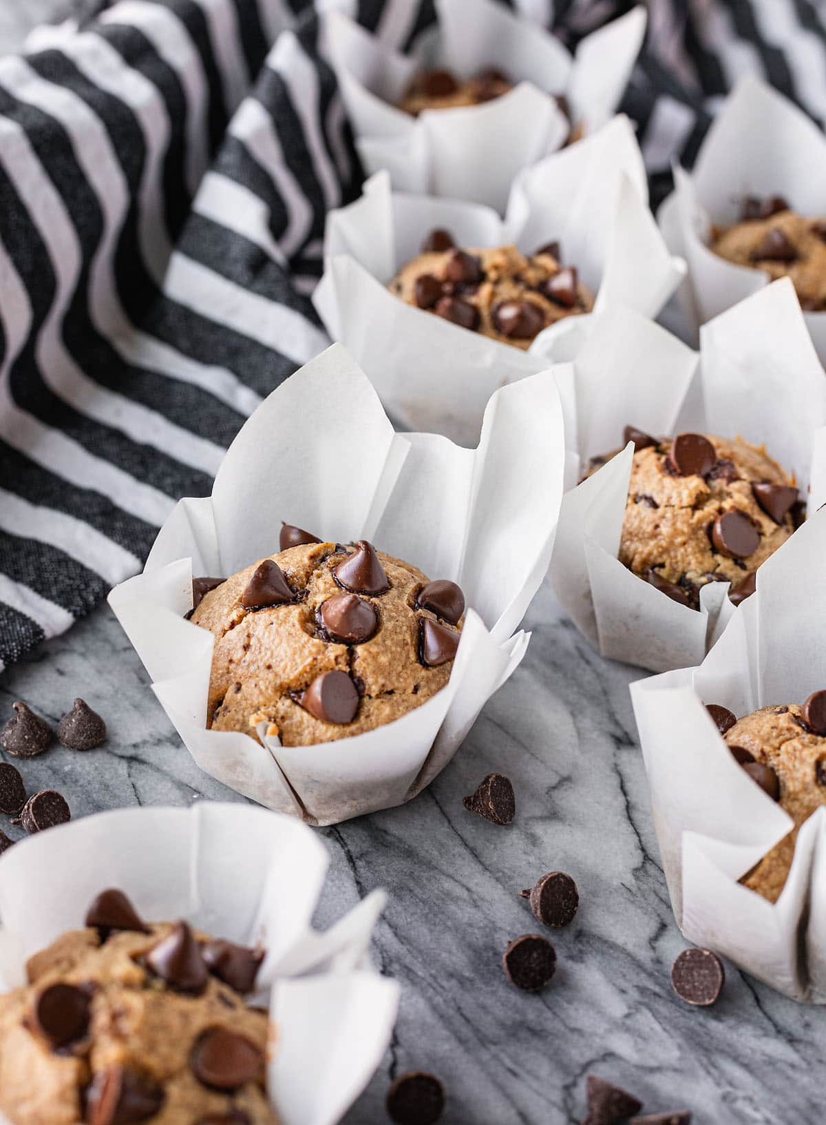 flourless peanut butter banana muffins topped with chocolate chips