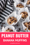 peanut butter banana chocolate chip muffins with a black and white dish towel