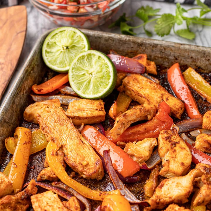 sheet pan chicken fajitas recipe with limes and pico de gallo