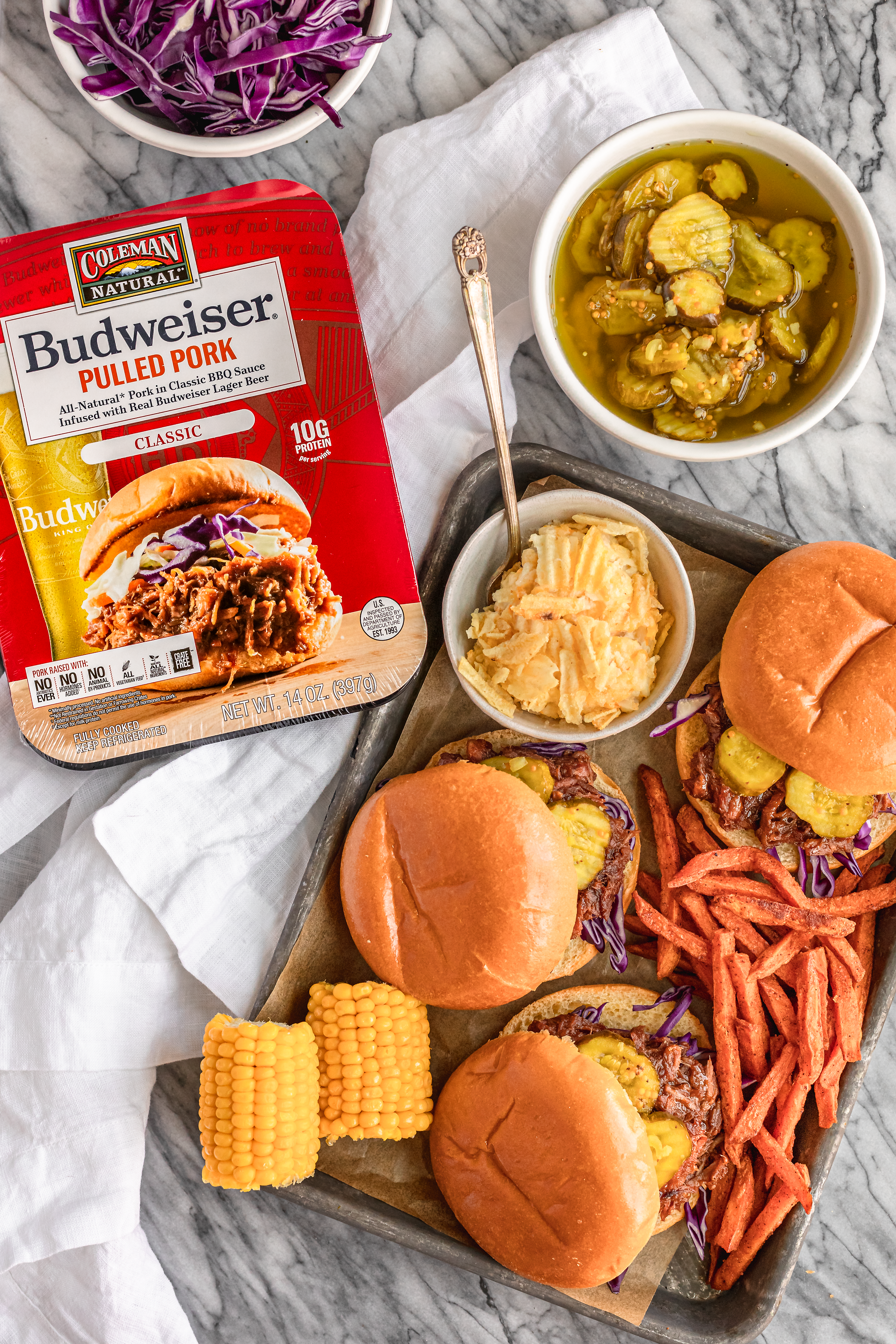 easy hashbrown casserole with pulled pork sandwiches sweet potato fries and corn on the cob