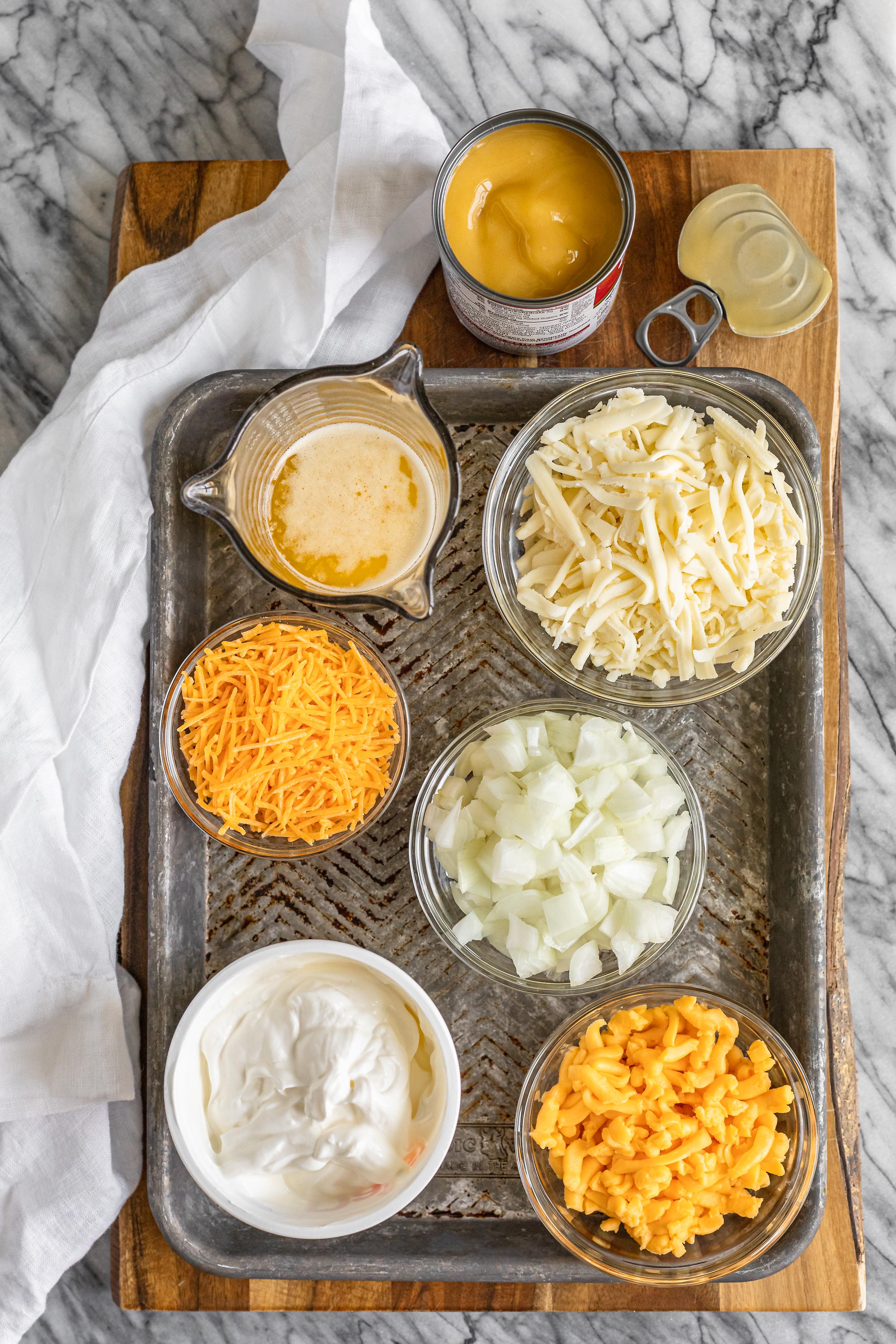 hash brown potato casserole ingredients on a baking sheet