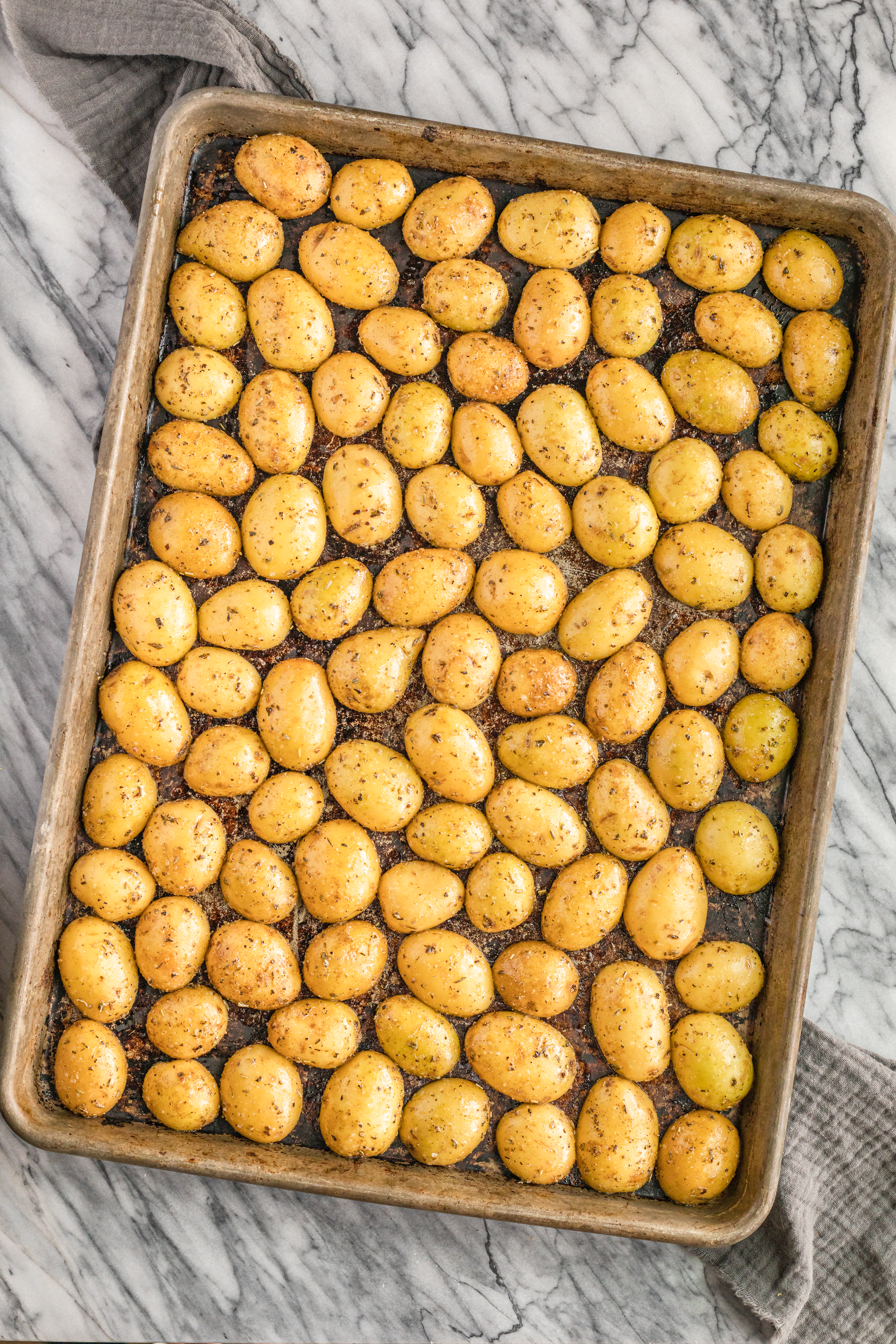 how long to roast baby potatoes arranged on a large baking sheet