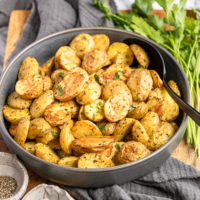 oven roasted baby potatoes recipe in a gray ceramic serving bowl